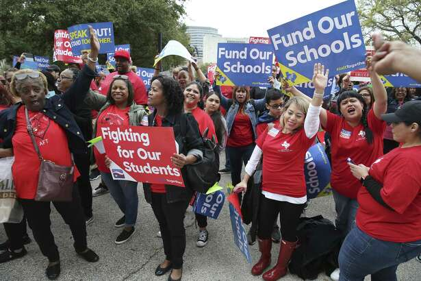 Members of the Northeast Houston American Federation of Teachers, left, and Pharr-San Juan-Alamo American Federation of Teachers, cheer during a rally at the State Capitol in Austin, Texas, Monday, March 11, 2019. A large crowd gathered at the capitol to urge the Texas Legislature for public school funding.