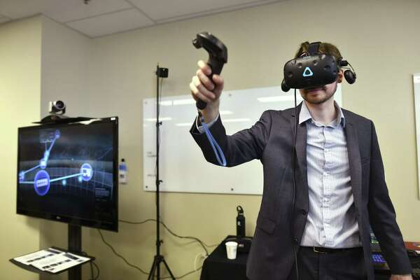 Jason Rauck, a project leader with Booz Allen Hamilton, demonstrates game-based learning for the 25th Air Force at the temporary home of UTSA's National Security Collaboration Center on Friday, March 29, 2019.