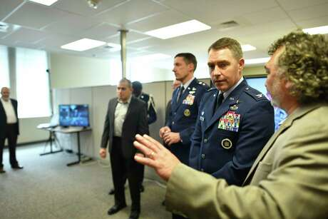 Air Force personnel attend an open house of UTSA's new $33 million National Security Collaboration Center on March 29, 2019. The center promotes cybersecurity and technological collaboration between government, industry and academia. The 25th Air Force, based at Joint Base San Antonio-Lackland, includes cyber and intelligence components.