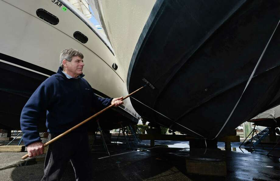 John Lorusso of Westport works on his boat, Treasure, on Thursday at Cove Marina in Norwalk. Photo: Erik Trautmann / Hearst Connecticut Media / Norwalk Hour