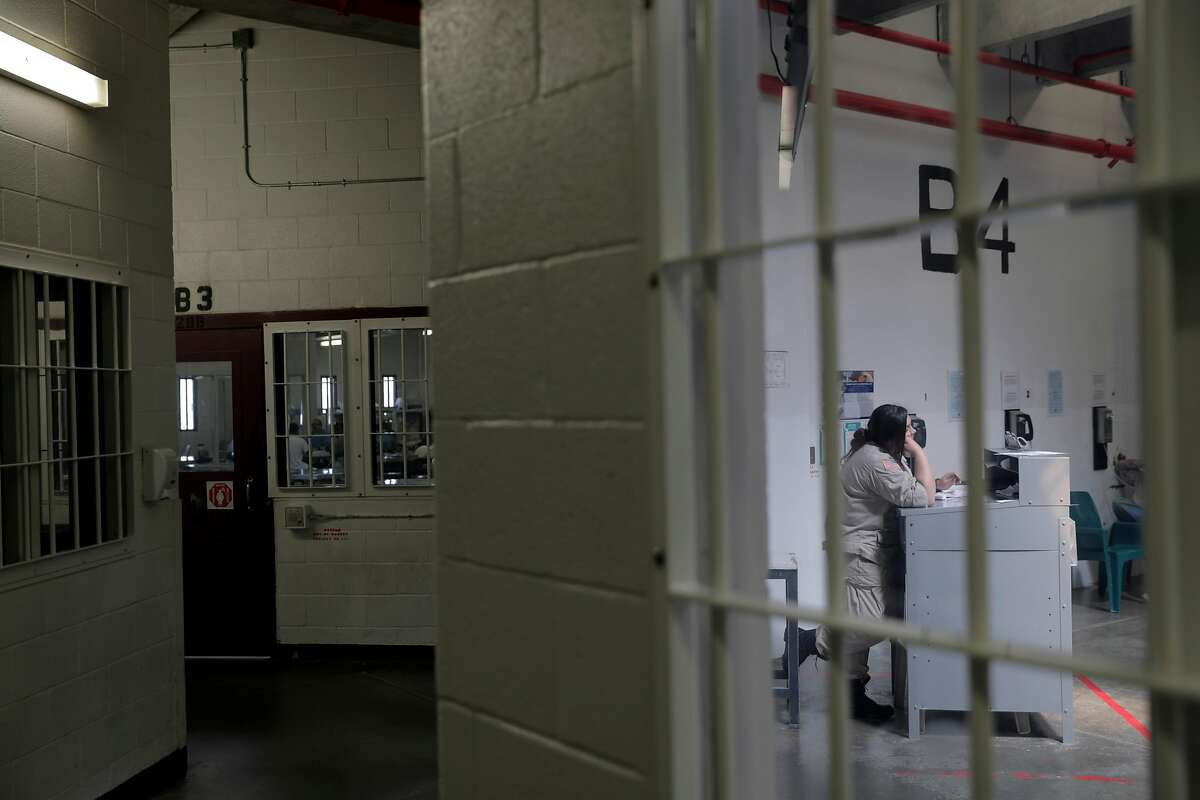 Corrections Officer Casta�eda keeps an eye on inmates in dormitory B4 at the Central Valley Modified Modified Community Correctional Facility in McFarland, Calif., on Thursday, March 28, 2019. California Gov. Gavin Newsom is trying to figure out how to empty privately run prisons of California inmates, who would be sent to state-run lockups like this one run by GEO Group.
