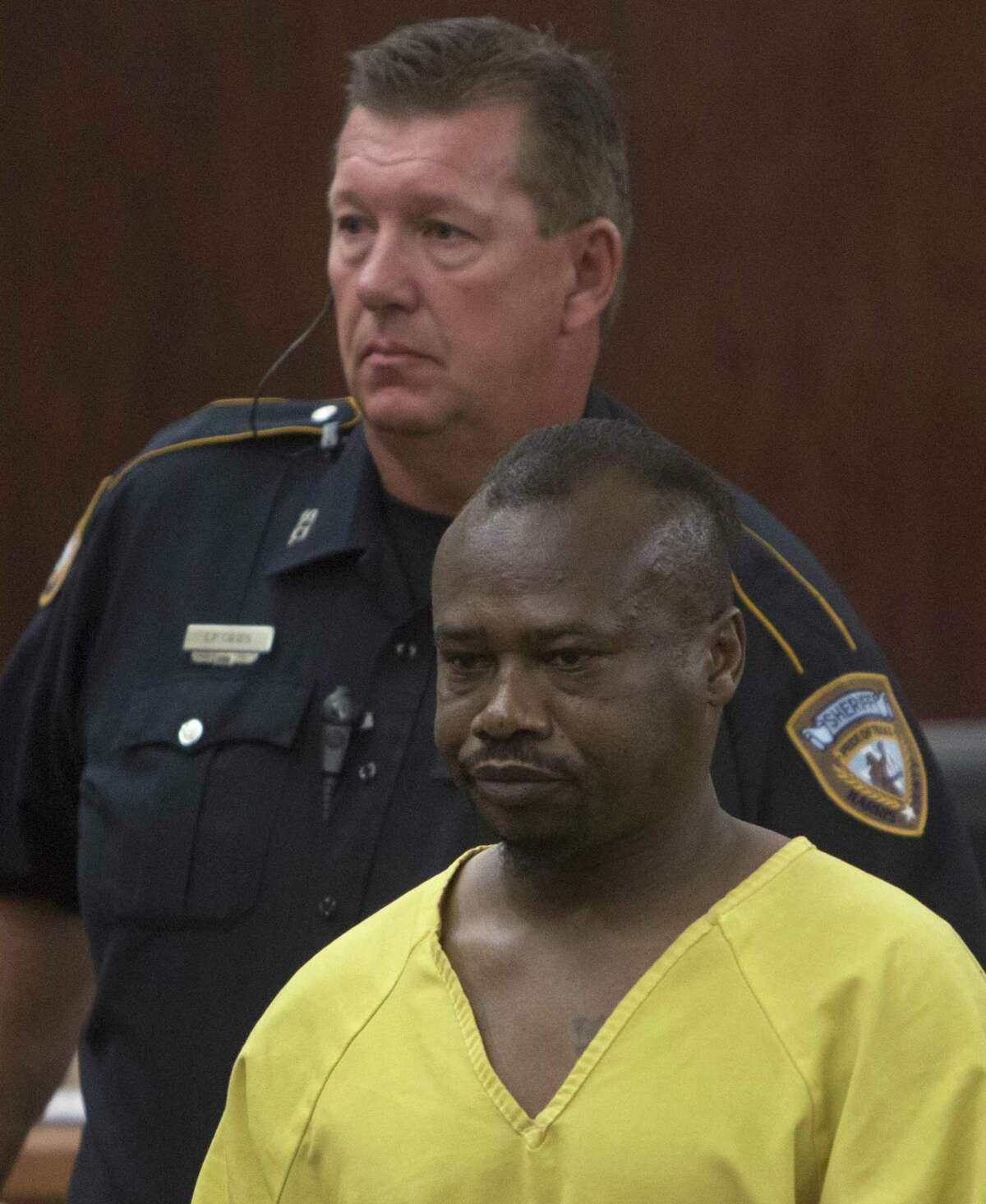 David Ray Conley appears in the 183rd State District Court, on Aug. 10, 2015, in Houston. Authorities said Conley had broken in through a window of a home, armed and with handcuffs, and methodically shot his ex-girlfriend Valerie Jackson, her husband and six children, including his own son. All eight died in the house.