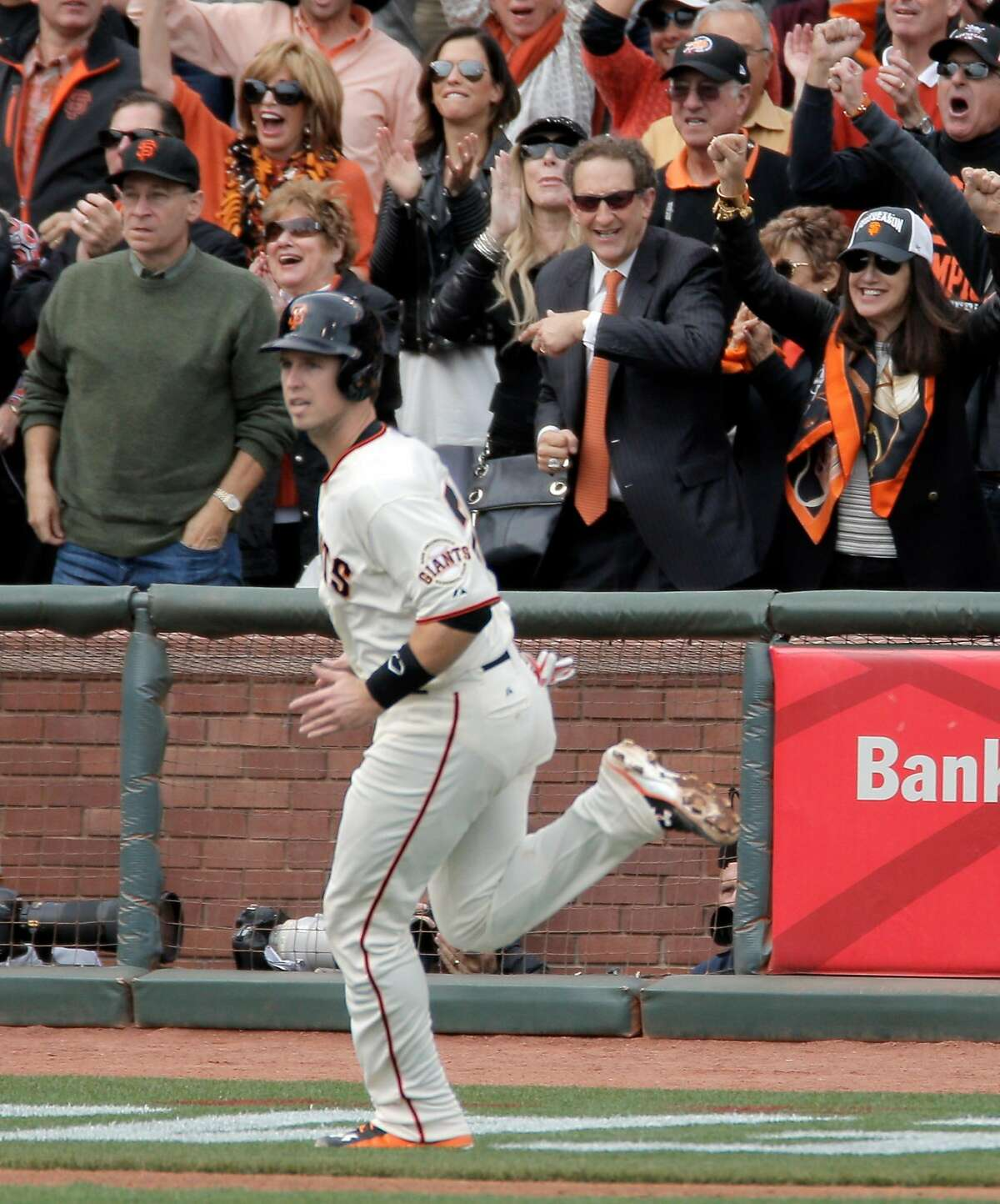 Larry Baer smiles as Giants Buster Posey scored in the first inning on a Hunter Pence double during Game 3 of the NLCS at AT&T Park on Tuesday, Oct. 14, 2014 in San Francisco, Calif.