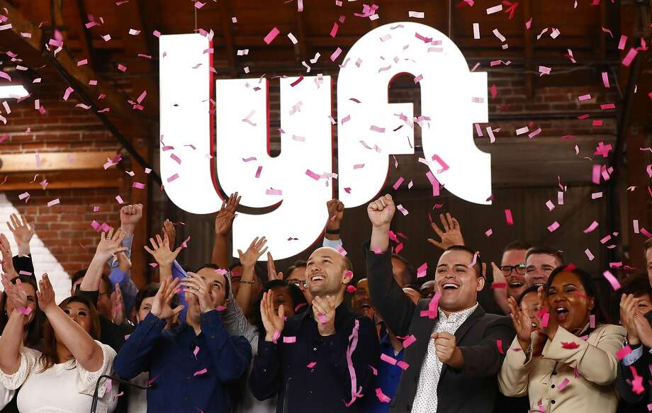 Confetti falls as Lyft CEO Logan Green and President John Zimmer ring the Nasdaq opening bell celebrating the company's initial public offering (IPO) on Mar. 29, 2019 in Los Angeles, Calif. The ride hailing app company's shares were initially priced at $72.  Photo: Mario Tama / Getty Images