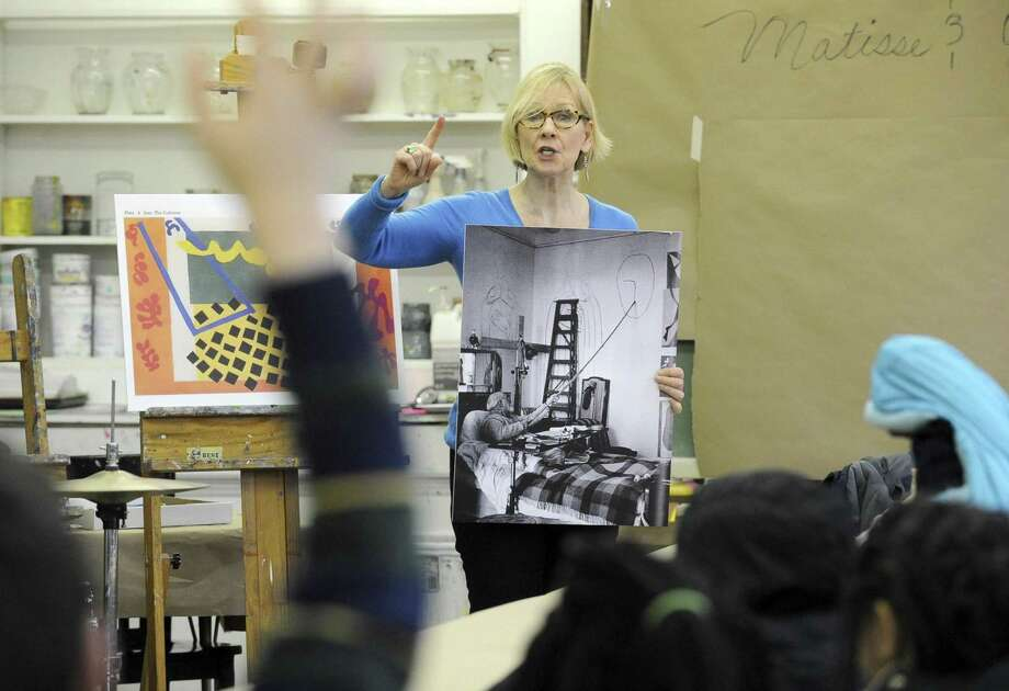 "Mary Newcomb of the Greenwich Art Society discusses the correlation between jazz music and artist Henri Matisse to first graders from Bridgeport's Read Elementary School during a Mingled Arts program at the art society's studio in Greenwich on Friday. Over 100 first graders listened to the Jim Clark Jazz trio, did a hands-on art project and talked about history and paintings related to the day's featured artist, Henri Matisse. ""This multi-sensory approach fully engages the students and has been shown to improve the student's creativity in their reading, writing, and also advance their socio-emotional development,"" said Mary Newcomb, the program's founder. ""Exposure to live music and culture is a real hit with the students. The arts help introduce us to ourselves and no matter what career path the students take, it's a fun and creative way to reach inside to discover your our own unique voice and then express it."" Photo: Matthew Brown / Hearst Connecticut Media / Stamford Advocate"