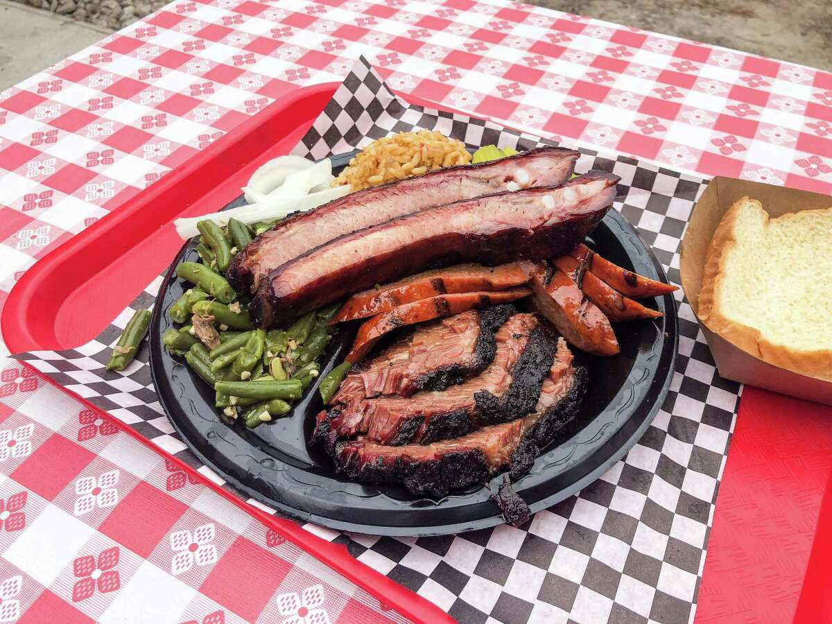 Texas trinity (brisket, ribs, sausage) with sides at Southern Q BBQ