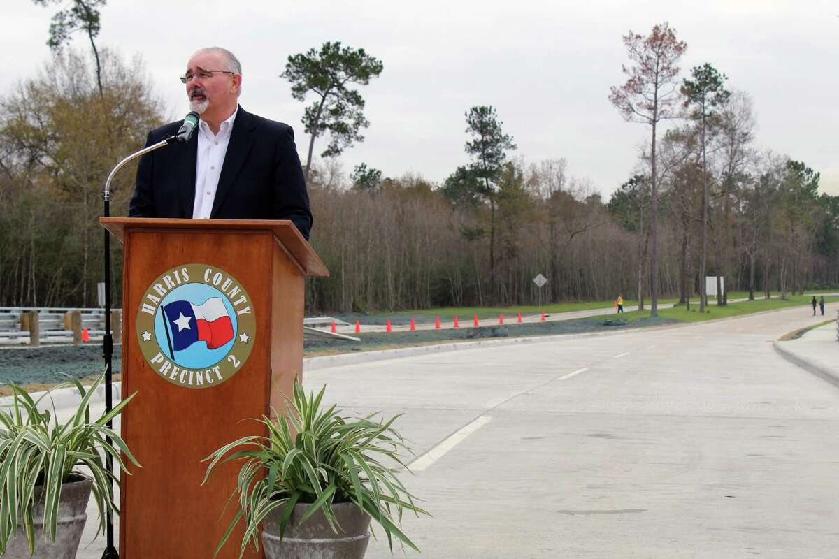 Pct. 4 Commissioner Jack Cagle speaks before the ribbon cutting ceremony for a new stretch of Woodland Hills Drive in Atascocita on Wednesday, Jan 10.