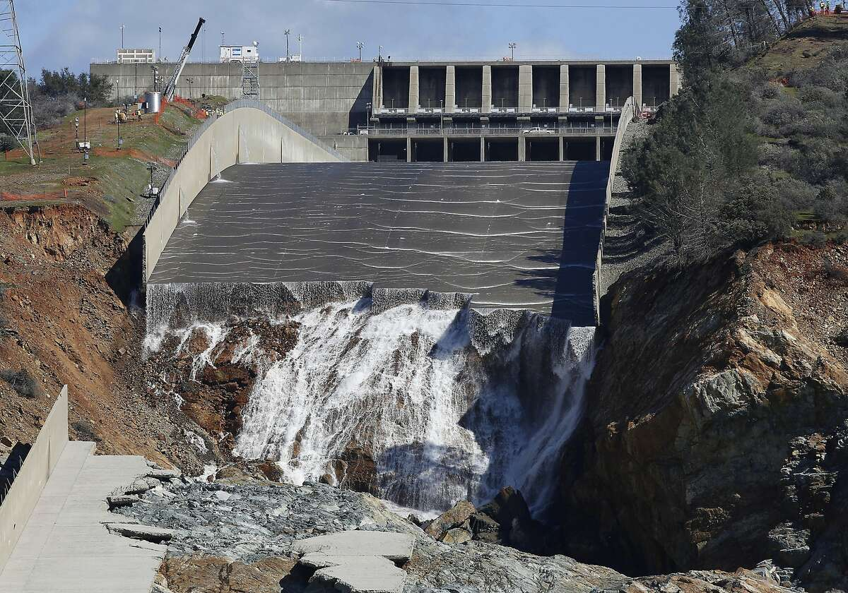 FILE - In this Feb. 28, 2017, file photo, water flows down the Oroville Dam's crippled spillway in Oroville, Calif. The federal government has rejected $306 million in reimbursements for California's repair of the nation's tallest dam, a state agency said Friday, March 8, 2019. That's just less than half of what California has so far requested from the Federal Emergency Management Agency to repair the Oroville Dam. FEMA has approved $333 million. State water officials put total reconstruction costs at $1.1 billion. (AP Photo/Rich Pedroncelli, File)