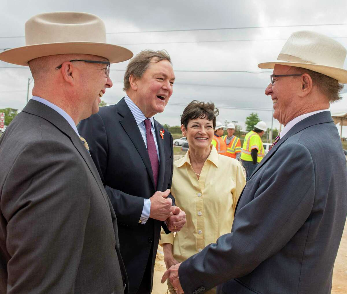 """Bexar County Commissioner Kevin Wolff, from left, Texas Transportation Commission Chairman J. Bruce Bugg Jr., state Sen. Donna Campbell and Bexar County Judge Nelson Wolff talk during a March 2019 groundbreaking on a U.S. 281 construction project. """"I'm a preacher of relationships,"""" Bugg says. """"Those relationships were built by the ability to really sit down and communicate."""""""