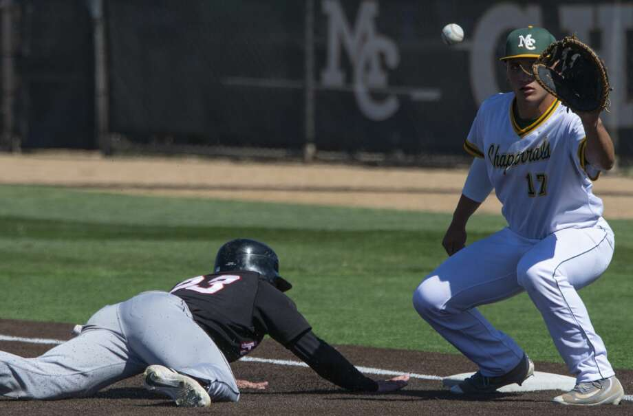 Midland College's Randy Huerta reaches for the ball on a pick-off attempt as Howard College's Trace Bucey dives back to first 03/29/19 at Christensen Stadium. Tim Fischer/Reporter-Telegram Photo: Tim Fischer/Midland Reporter-Telegram