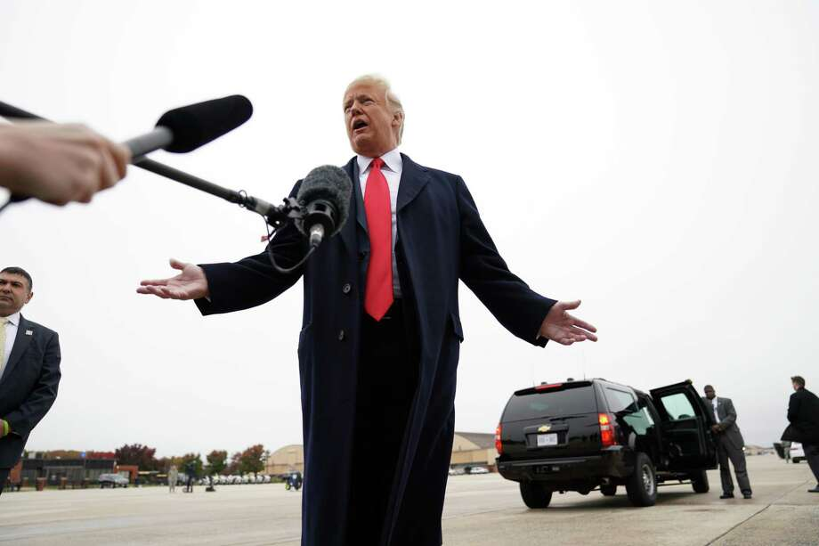 President Donald Trump speaks to reporters at Joint Base Andrews in Maryland on Nov. 5, 2018. It is still unclear why the special counsel's office did not render a judgment on whether President Trump illegally obstructed the Russia inquiry. Photo: DOUG MILLS /NYT / NYTNS