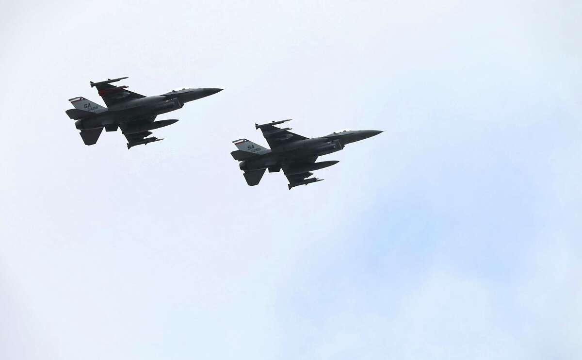 Two F16s perform a fllyover during the 46th annual Freedom Flyers Reunion, on Friday, March 29, 2019, at Joint Base San Antonio - Randolph.