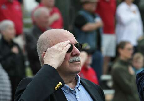 Col. Joe Milligan salutes during the national anthem during the 46th annual Freedom Flyers Reunion, on Friday, March 29, 2019, at Joint Base San Antonio - Randolph. Milligan was held in captivity after being shot down over North Vietnam.