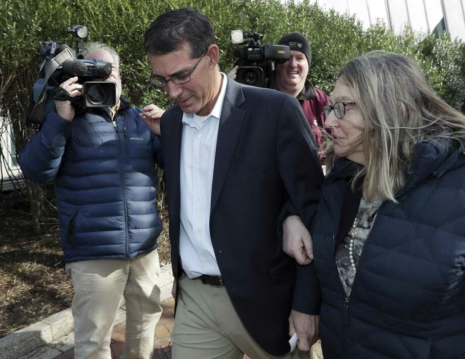 Michael Center, left, former Texas tennis coach, departs federal court in Boston with an unidentified woman after facing charges in a nationwide college admissions bribery scandal. Worthy students were pushed aside in this scandal. Photo: Charles Krupa /Associated Press / Copyright 2019 The Associated Press. All rights reserved