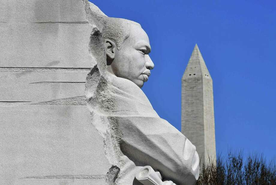 """The Washington Memorial is seen behind the """"Stone of Hope"""" statue at the Martin Luther King Jr. Memorial in Washington, D.C. on March 19. Photo: MANDEL NGAN /AFP /Getty Images / AFP or licensors"""