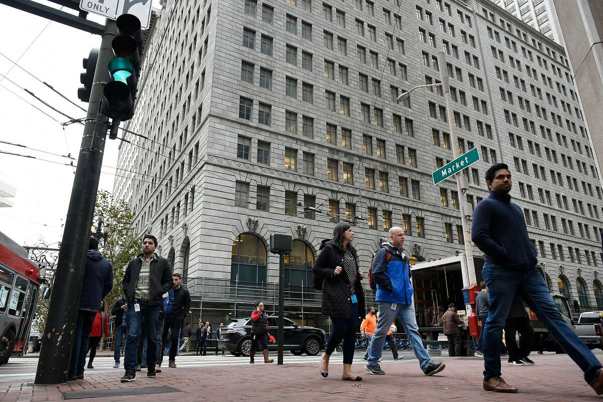 People pass in front of PG&E's headquarters on Market Street in San Francisco, CA, on Monday January 14, 2019.
