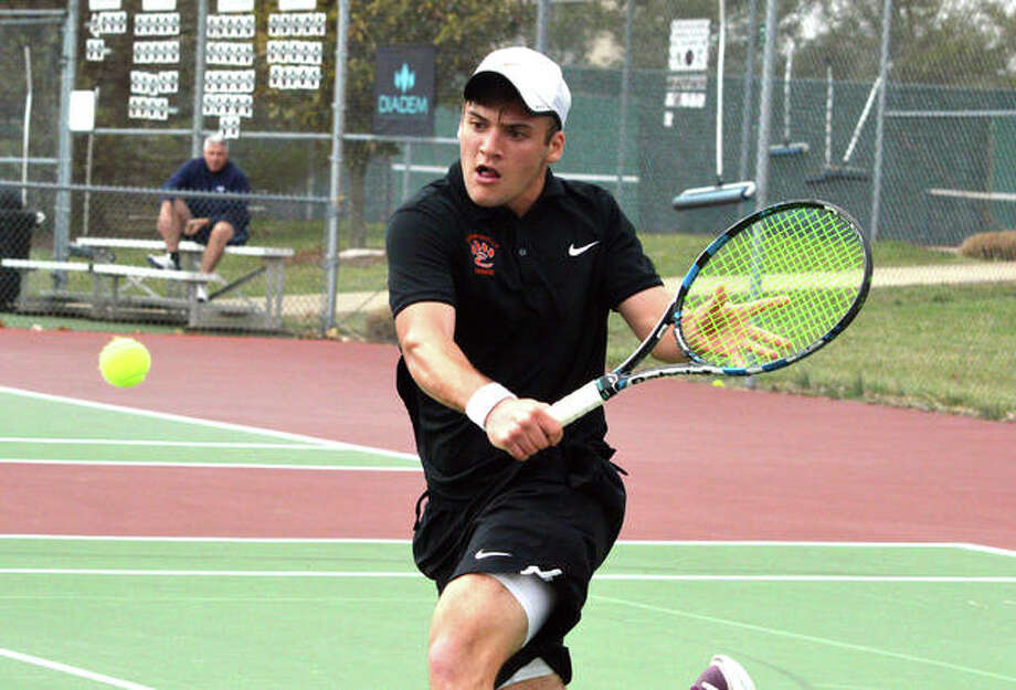 Edwardsville senior Seth Lipe reaches for a backhand during his No. 2 singles match against Riverfield High School from Tulsa, Okla., on Friday at the EHS Tennis Center. Photo: Scott Marion/Intelligencer