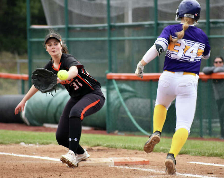 Edwardsville first baseman Mackenzie Owens reaches for the throw to record the putout against Civic Memorial.