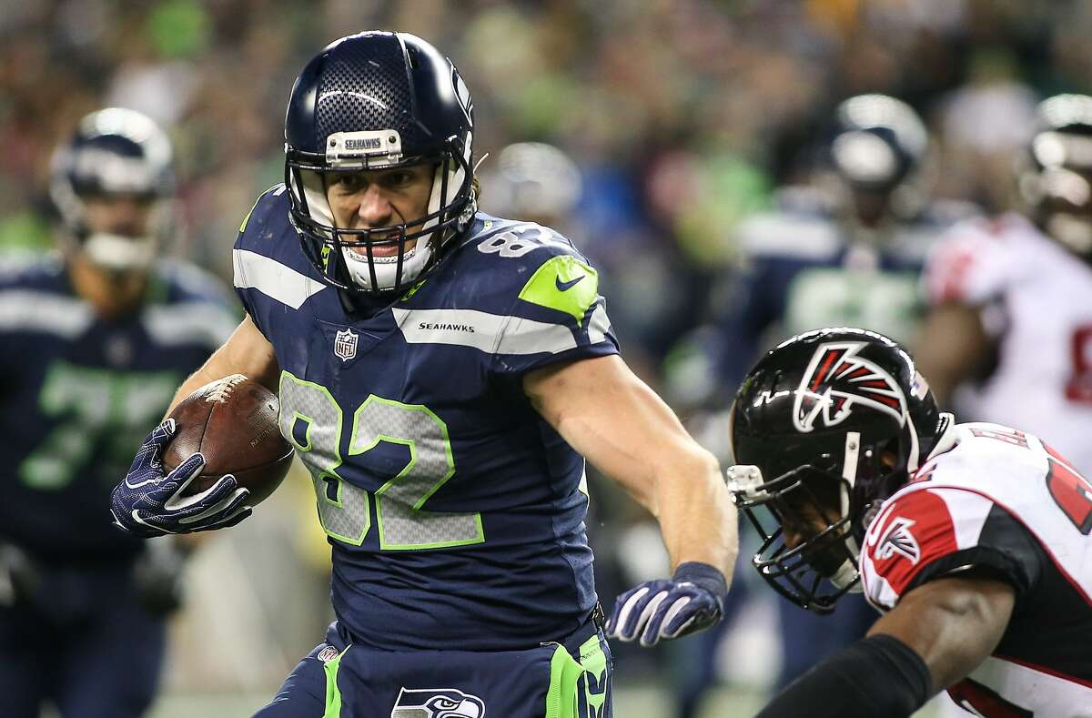 Seahawks tight end Luke Willson is chased down by Falcons safety Keanu Neal in the second half at CenturyLink Field on Monday, Nov. 20, 2017. (GRANT HINDSLEY, seattlepi.com)