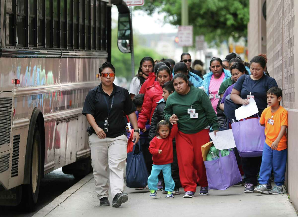 Migrants released from Texas detention centers arrive by the bus loads, on Friday, March 29, 2019, at the San Antonio bus station.