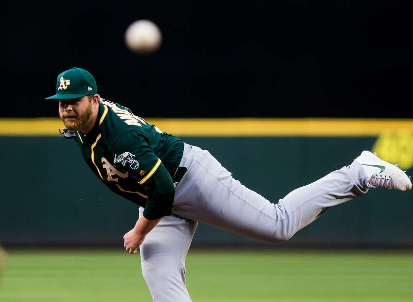 Brett Anderson #30 of the Oakland Athletics delivers against the Seattle Mariners at Safeco Field on May 2, 2018 in Seattle, Washington.
