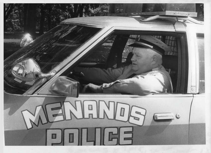 Menands, New York Police Chief James Claydon at wheel of one of their two police cars. May 16, 1980 (Bud Hewig/Times Union Archive)