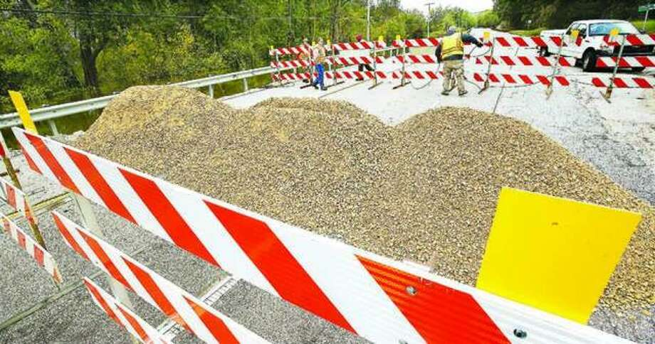 Workers from the Illinois Department of Transportation had piled rock up on Illinois Route 100 on the west side of Grafton to prevent motorists from driving around the barricades last October. Photo: John Badman | Telegraph File Photo