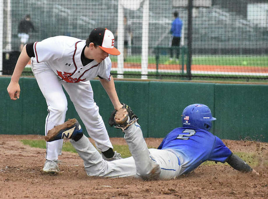 Edwardsville's Matt Boyer attempts to tag out a runner at the plate during the third inning of Friday's game against Columbia at Tom Pile Field. Photo: Matt Kamp/The Intelligencer