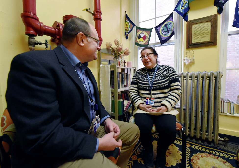 Rev. Jake Marvel has a check in with Chaplin Resident Kylie Makowsky in the Department of Pastoral Care Office on Wednesday, Feb. 20, 2019 at Albany Med in Albany, NY. (Phoebe Sheehan/Times Union)