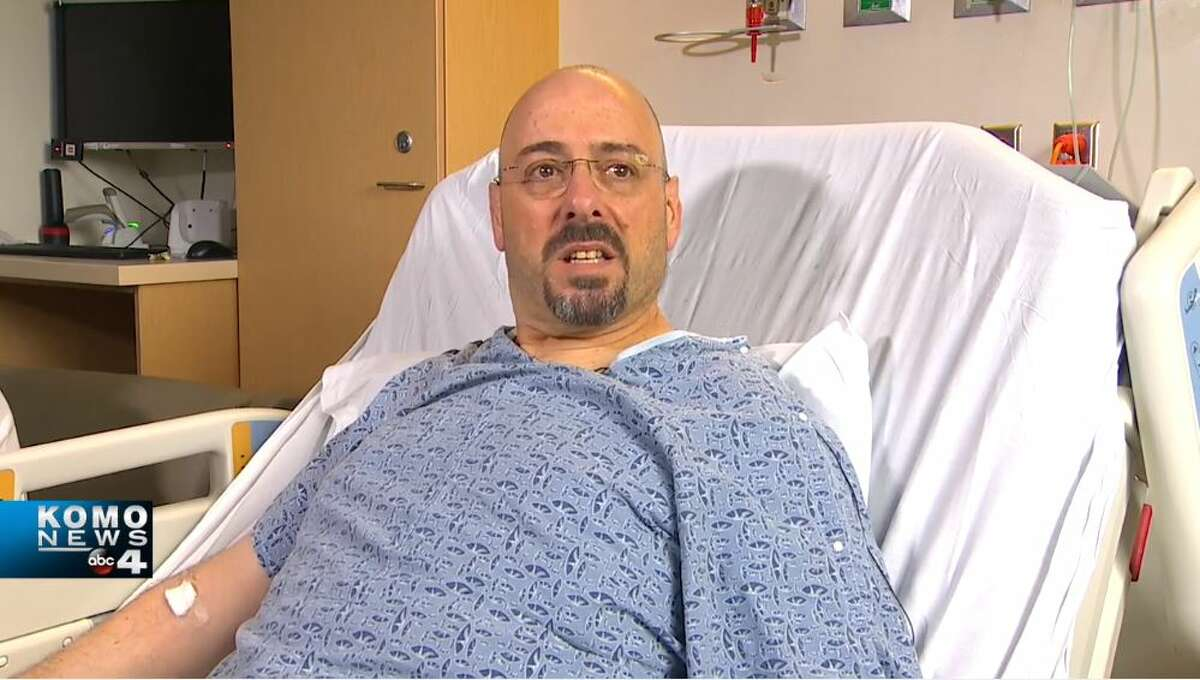 Eric Stark, 53, recovers in a hospital bed at Harborview Medical Center two days after he was shot while driving his bus in Lake City on March 27, 2019.
