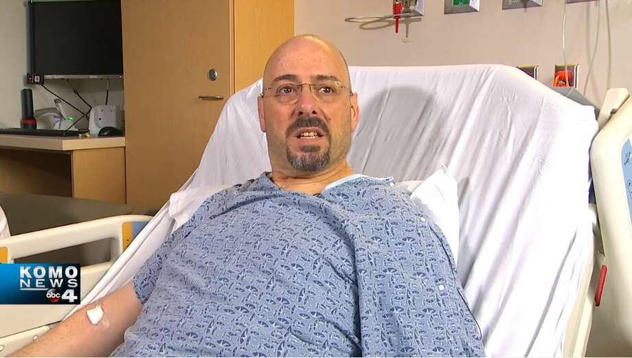 Eric Stark, 53, recovers in a hospital bed at Harborview Medical Center two days after he was shot while driving his bus in Lake City on March 27, 2019. Photo: KOMO News Photo