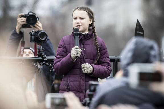 Swedish climate activist Greta Thunberg attends the 'Friday For Future' rally in Berlin, Germany, Friday, March 29, 2019. Thousands of students are gathering in the German capital, skipping school to take part in a rally demanding action against climate change. (Michael Kappeler/dpa via AP)