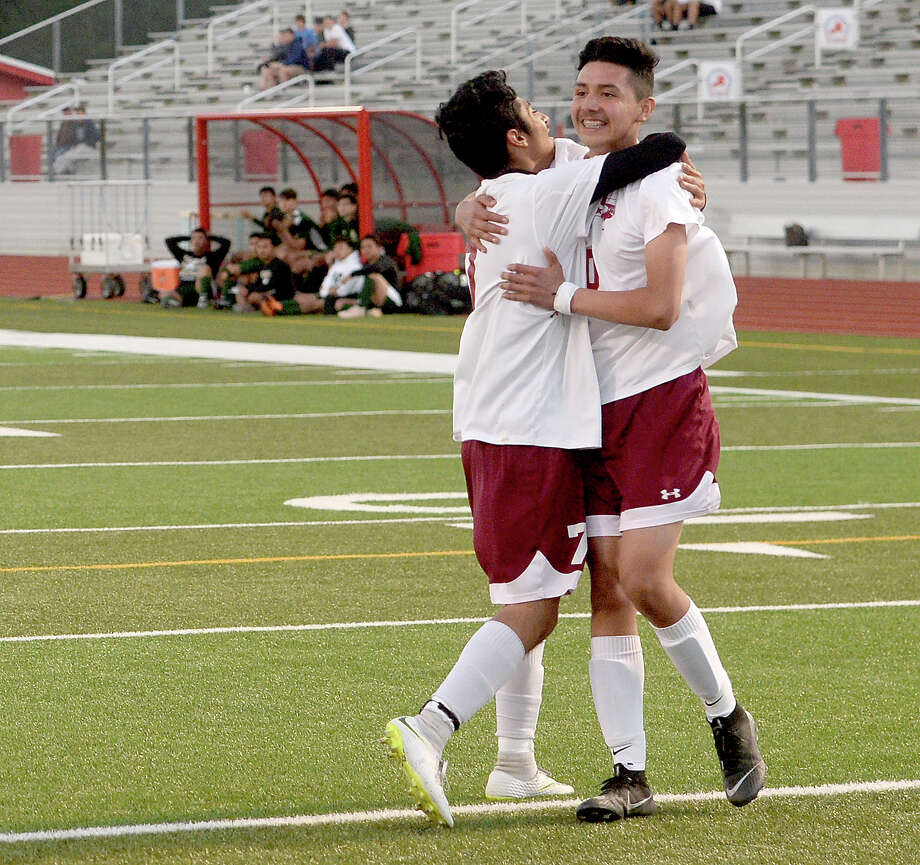Jasper's Adan Segovia (left) celebrates with Luis Duarte after Duarte brings in the first goal against East Chambers during their playoff game Friday at Lumberton High School Photo taken Friday, March 29, 2019 Kim Brent/The Enterprise Photo: Kim Brent, The Enterprise / BEN