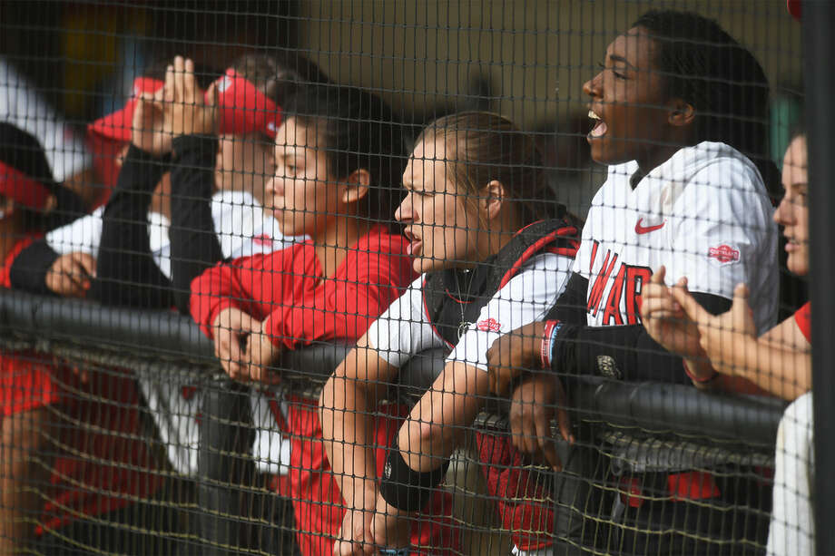 Lamar softball players watch as the Cards play against Central Arkansas at the Cardinal Stadium Friday evening. Photo: Guiseppe Barranco / The Enterprise