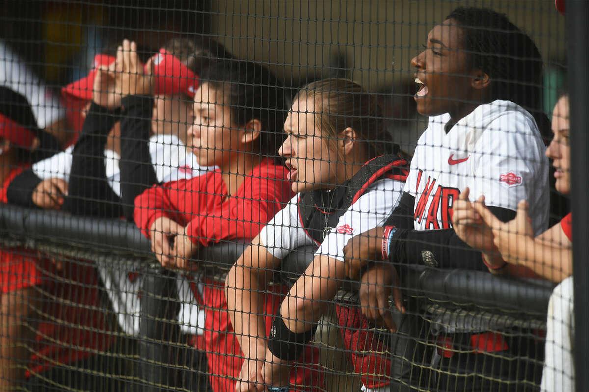 Lamar softball players watch as the Cards play against Central Arkansas at the Cardinal Stadium Friday evening.