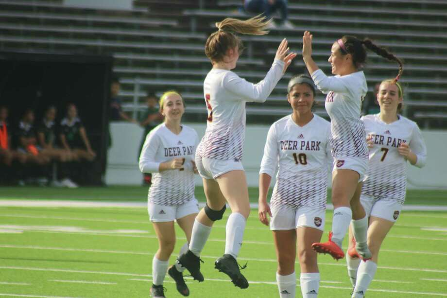 Camden Chance (5) celebrates a goal with a teammate Friday night. It upped the lead to 2-0. Looking on is the trio of Emma Cone (2), Arely Alaniz (10) and Abby Wheeler (7). Photo: Robert Avery