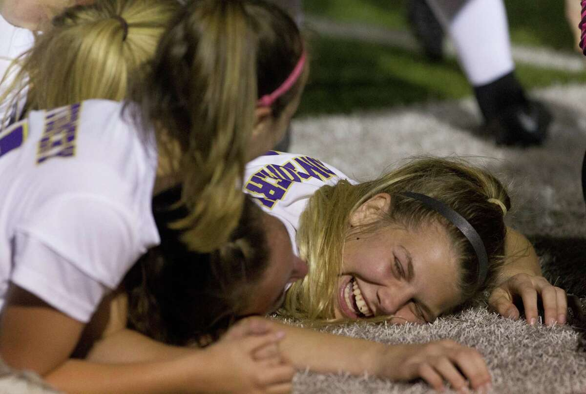 Magnolia palyers react after defeating Magnolia 2-1 in double overtime of a Region III-5A bi-district soccer match at Magnolia High School, Friday, March 29, 2019, in Magnolia.