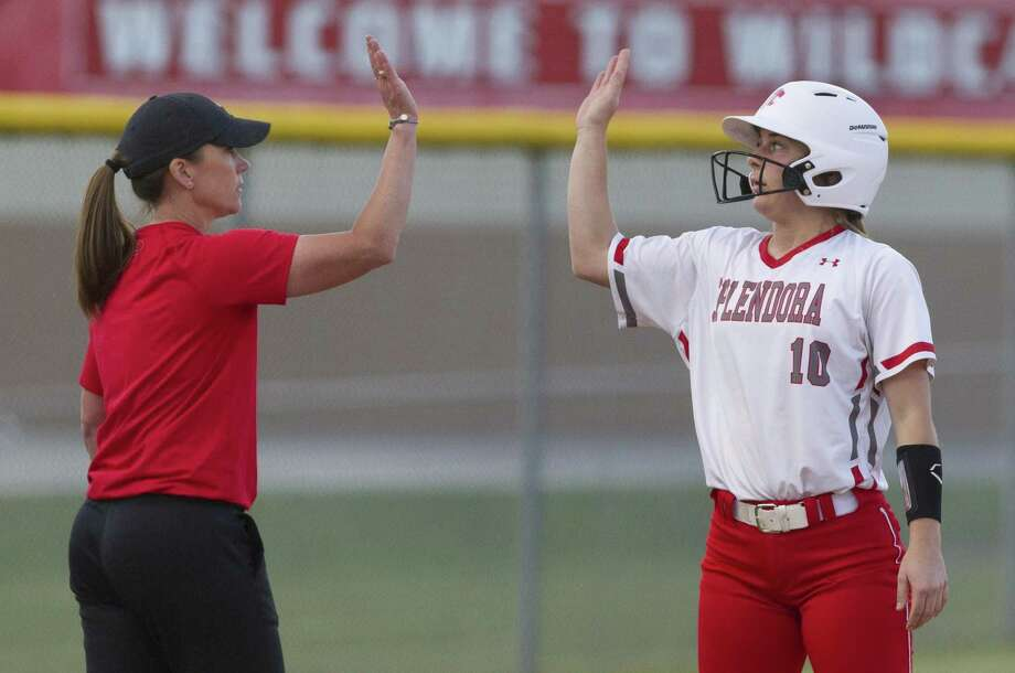 Splendora coach Deana Eubanks, seen here high-fiving Kaicey Hagler, was named District 21-4A Coach of the Year after leading the Ladycats to an outright district title. Photo: Jason Fochtman, Houston Chronicle / Staff Photographer / © 2019 Houston Chronicle