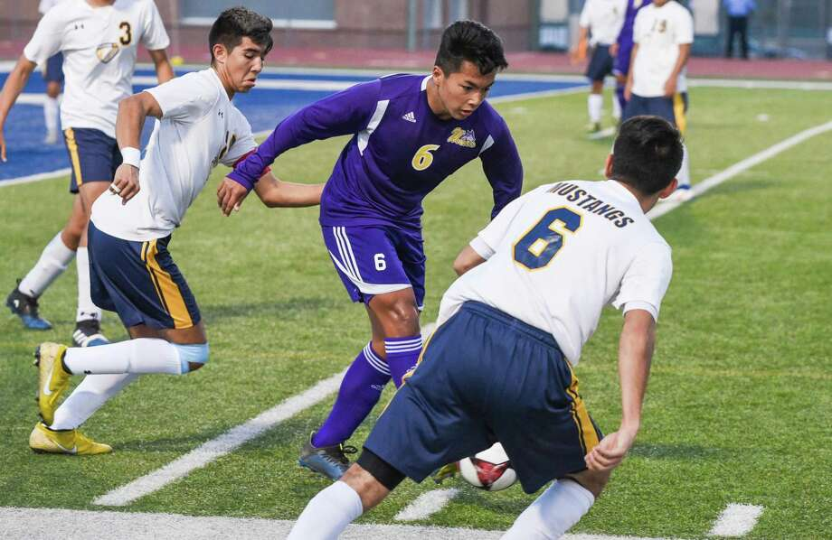 Luis Valdez and LBJ rolled 5-1 over McAllen Memorial on Friday at the SAC as the Wolves opened their 15th straight postseason appearance. Photo: Danny Zaragoza /Laredo Morning Times