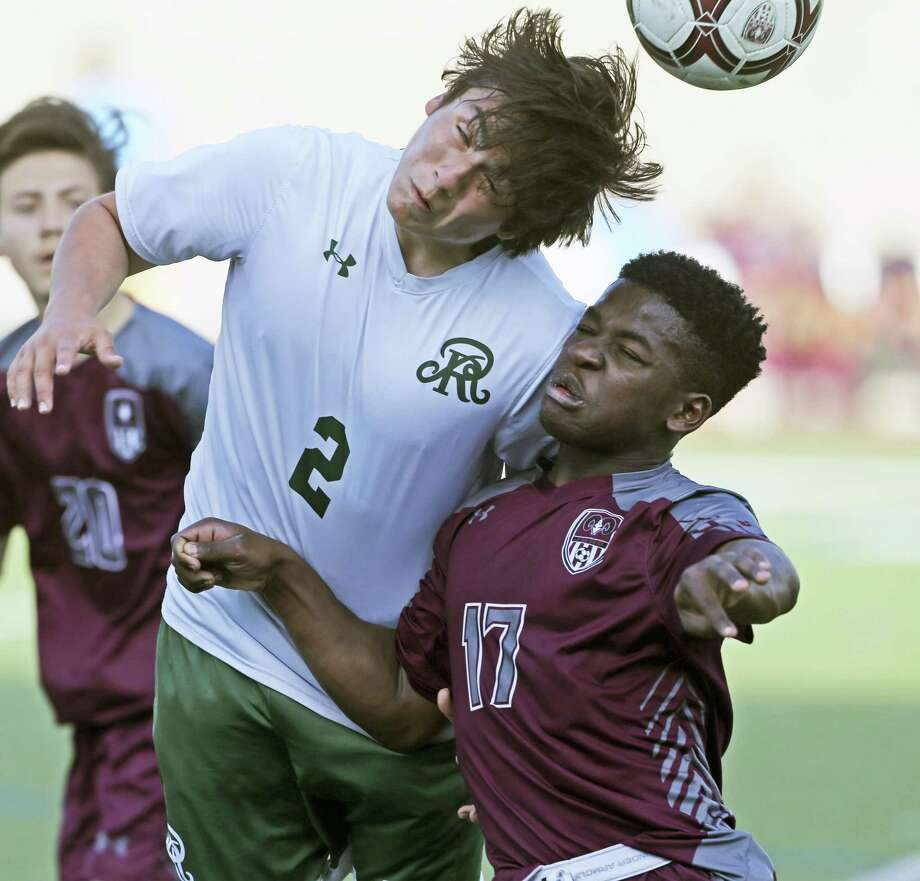 The Rattler's Sergio Gonzalez wins control of the ball with a header over Joaquim John as Reagan plays Marshall in boys 6A bidistrict soccer at Farris Stadium on March 29, 2019. Photo: Tom Reel, Staff / Staff Photographer / 2019 SAN ANTONIO EXPRESS-NEWS