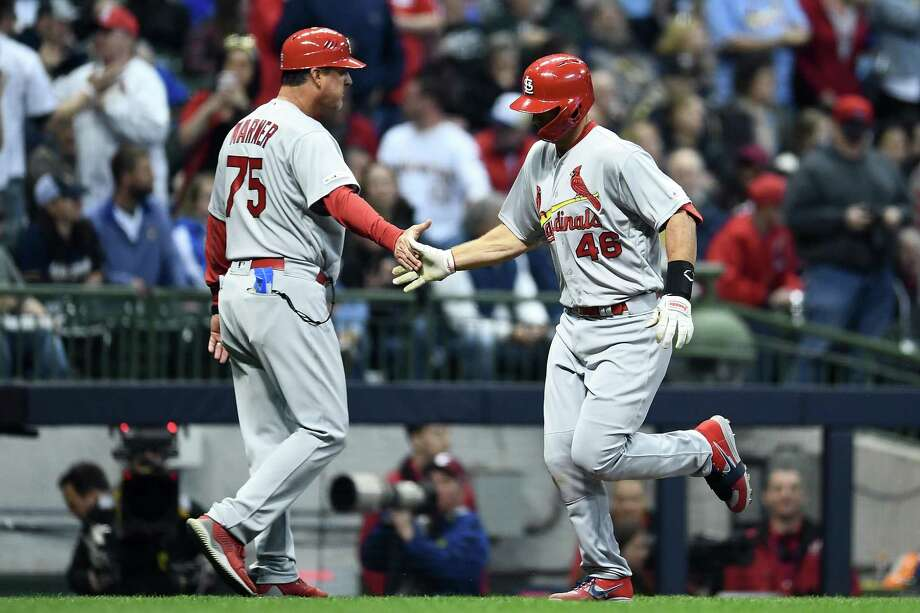 Paul Goldschmidt of the St. Louis Cardinals is congratulated by third base coach Ron Warner following a home run during the sixth inning of a game against the Milwaukee Brewers at Miller Park on March 29. Photo: Stacy Revere, Stringer / Getty Images / 2019 Getty Images