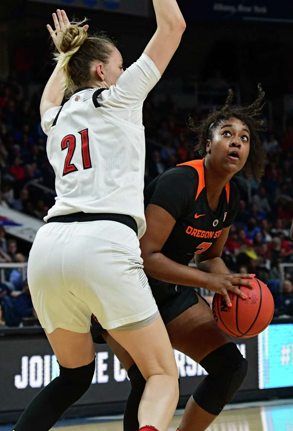 Oregon State's Madison Washington drives to the net against Louisville's Kylee Shook in a semifinal for the Albany Regional of the NCAA Women's Basketball Championship at the Times Union Center on Friday, March 29, 2019 in Albany, N.Y. (Lori Van Buren/Times Union)