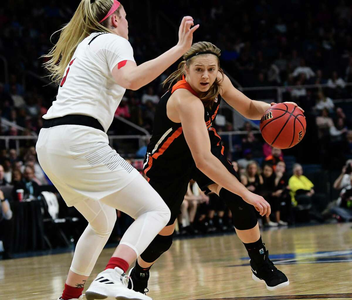 Oregon State's Mikayla Pivec drives to the net against Louisville's Sam Fuehring in a semifinal for the Albany Regional of the NCAA Women's Basketball Championship at the Times Union Center on Friday, March 29, 2019 in Albany, N.Y. (Lori Van Buren/Times Union)