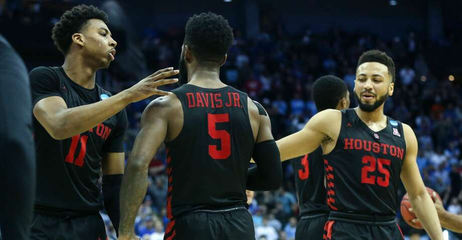 Houston guards Nate Hinton (11), Corey Davis Jr. (5) and Galen Robinson Jr. (25) embrace at the end of a 62-58 loss to Kentucky in the NCAA Midwest Regional at Sprint Center in Kansas City on Friday, March 29, 2019. Photo: Elizabeth Conley/Staff Photographer
