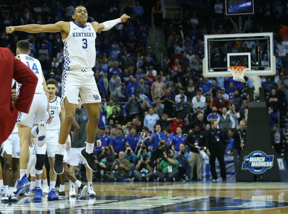 Kentucky guard Keldon Johnson (3) leaps in the air after UK beat Houston 62-58 in the NCAA Midwest Regional semifinal at Sprint Center in Kansas City on Friday, March 29, 2019.