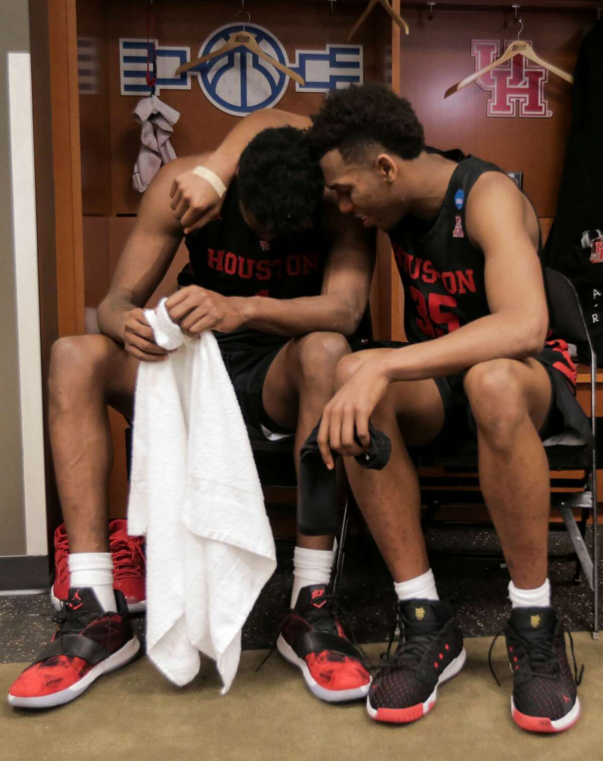 Houston center Chris Harris Jr. (1) and Houston forward Fabian White Jr. (35) embrace in the locker room after the Cougars were eliminated from the NCAA Tournament with a 62-58 loss to Kentucky in the Midwest Regional at Sprint Center in Kansas City on Friday, March 29, 2019.