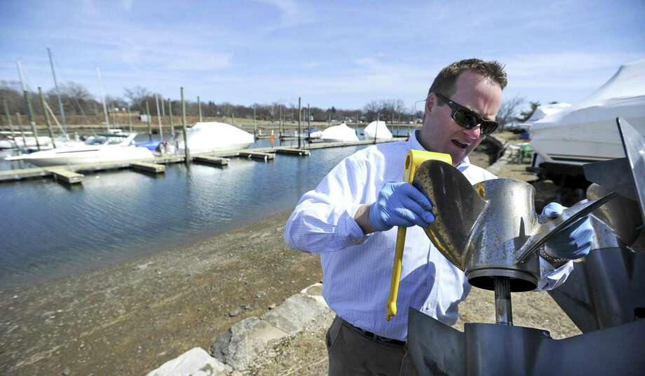 Jeff Condlin of Stamford installs propellers as he preps his boat for the upcoming boating season on March 27, 2019 in Stamford, Connecticut. Condlin, a member of the Halloween Yacht Club, was taking care of routine maintenance, that will include painting the haul prior to a mid-April launch. Photo: Matthew Brown / Hearst Connecticut Media / Stamford Advocate