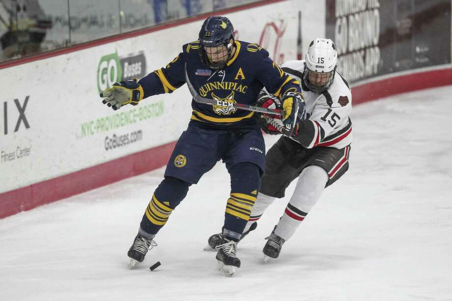 Quinnipiac's Scott Davidson, left, battles for the puck during a game against Brown this season. Photo: Stew Milne / Associated Press / Copyright 2019 The Associated Press. All rights reserved.