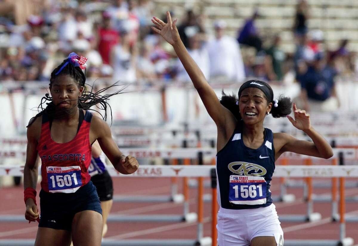 Kattiana Ealy-Pulido of Klein Collins reacts after finishing first ahead of Winter Bogan of Atascocita in the Class 6A girls 100-meter hurdles during the UIL State Track & Field Championships at Mike A. Myers Stadium, Saturday, May 12, 2018, in Austin.