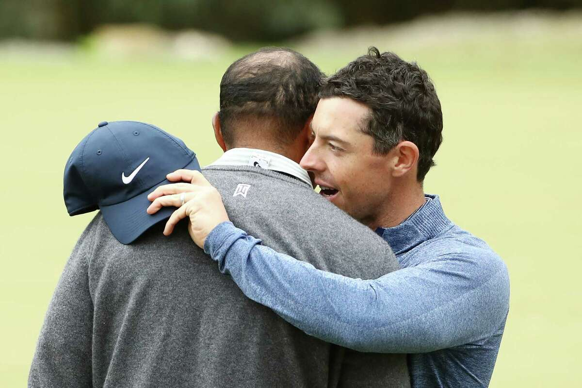 AUSTIN, TEXAS - MARCH 30: Tiger Woods of the United States embraces Rory McIlroy of Northern Ireland after defeating him 2&1 during the fourth round of the World Golf Championships-Dell Technologies Match Play at Austin Country Club on March 30, 2019 in Austin, Texas.